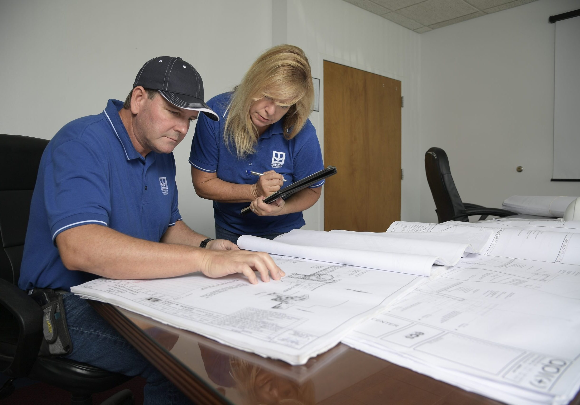 Two Employees Reviewing Plans